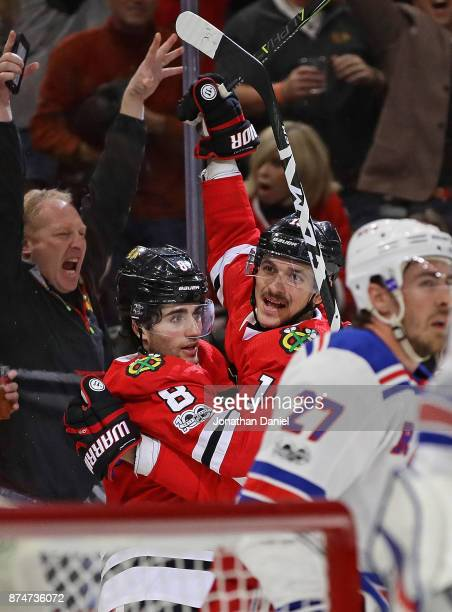 Nick Schmaltz and Artem Anisimov of the Chicago Blackhawks celebrate Anisimovs' third goal of the game against the New York Rangers at the United...