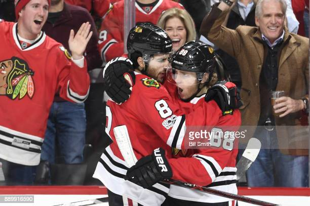Nick Schmaltz and Patrick Kane of the Chicago Blackhawks celebrate after Schmaltz scored against the Arizona Coyotes in the third period at the...