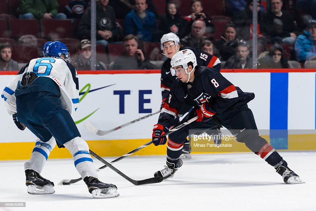 Nick Schmaltz #8 of Team United States skates with the puck near Joonas Lyytinen #6 of Team Finland during the 2015 IIHF World Junior Hockey Championship game at the Bell Centre on December 26, 2014 in Montreal, Quebec, Canada. Team United States defeated Team Finland 2-1 in a shootout.