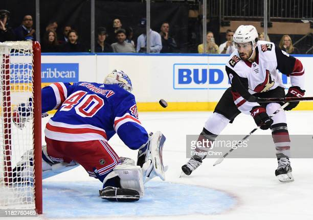Nick Schmaltz of the Arizona Coyotes attempts a shot on Alexandar Georgiev of the New York Rangers during the first period of their game at Madison...