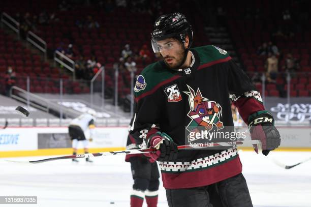 Nick Schmaltz of the Arizona Coyotes juggles the puck on his stick while preparing for a game against the Vegas Golden Knights at Gila River Arena on...