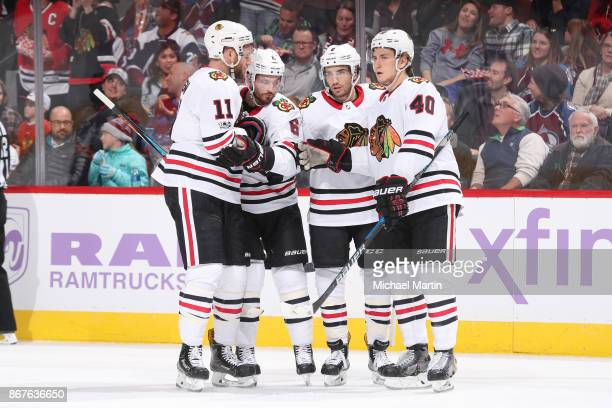 Nick Schmaltz of the Chicago Blackhawks celebrates a goal against the Colorado Avalanche with teammates Cody Franson John Hayden and Michael Kempny...