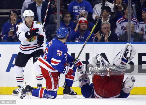 Nick Schmaltz of the Chicago Blackhawks celebrates his goal at 856 of the second period as Henrik Lundqvist of the New York Rangers tumbles out of...
