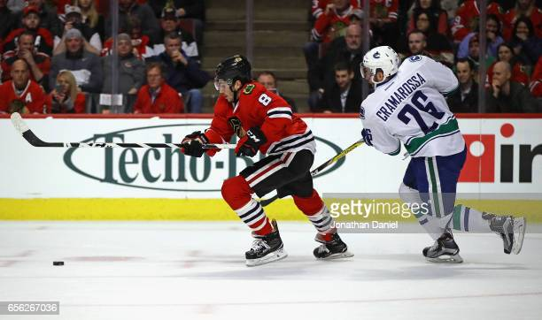 Nick Schmaltz of the Chicago Blackhawks chases the puck followed by Joseph Cramarossa of the Vancouver Canucks at the United Center on March 21 2017...