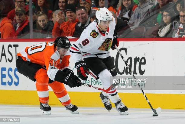 Nick Schmaltz of the Chicago Blackhawks controls the puck while being pursued by Jordan Weal of the Philadelphia Flyers on November 9 2017 at the...
