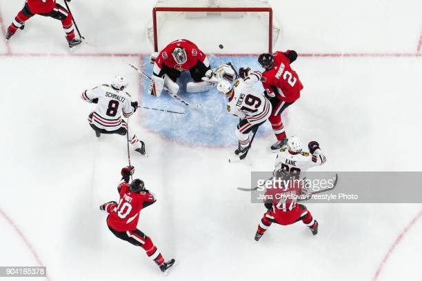 Nick Schmaltz of the Chicago Blackhawks scores his second powerplay goal in the second period as teammates Mike Condon Dion Phaneuf JeanGabriel...