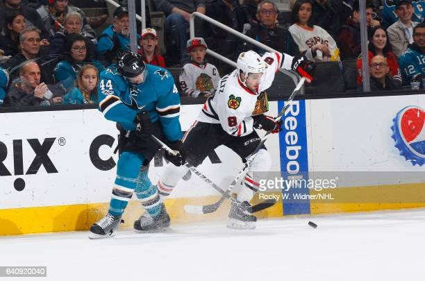 Nick Schmaltz of the Chicago Blackhawks skates after the puck against MarcEdouard Vlasic of the San Jose Sharks at SAP Center on January 31 2017 in...