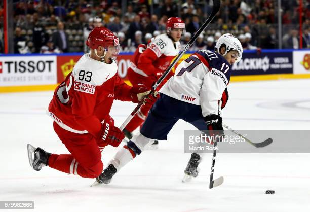 Nick Schmaltz of USA challenges Peter Regin of Denmark for the puck during the 2017 IIHF Ice Hockey World Championship game between USA and Denmark...