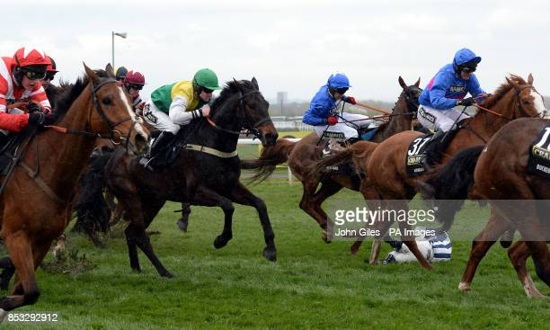 Nick Schofield the jockey of Teaforthree lies on the turf at the Chair in the Crabbies Grand National during Grand National Day of the Crabbie's...