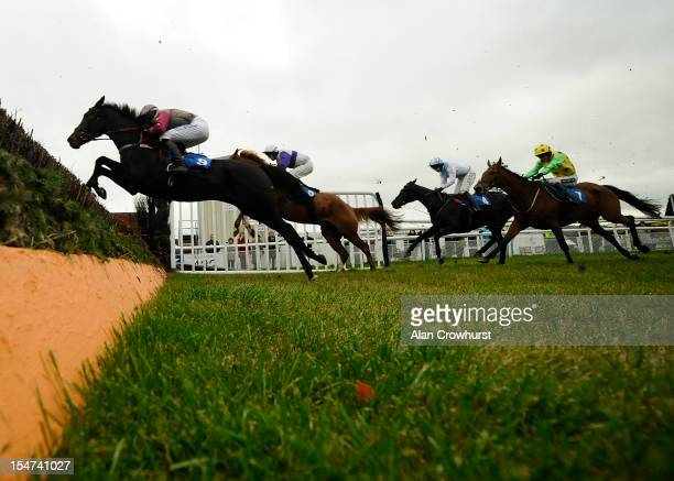 Nick Scholfield riding On The Bridge to clear the water before winning The Vera Davies Cup at Ludlow racecourse on October 25 2012 in Ludlow England