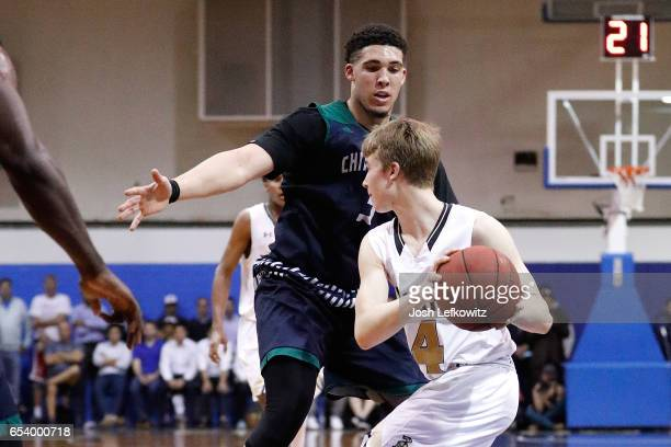 Nick Schrader of Bishop Montgomery High School looks to pass the ball while being guarded by LiAngelo Ball of Chino Hills High School during the game...