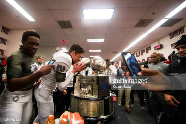 Nick Schrage of the Army Black Knights celebrates a win over the Navy Midshipmen by kissing the CommanderinChief trophy in the locker room at Lincoln...