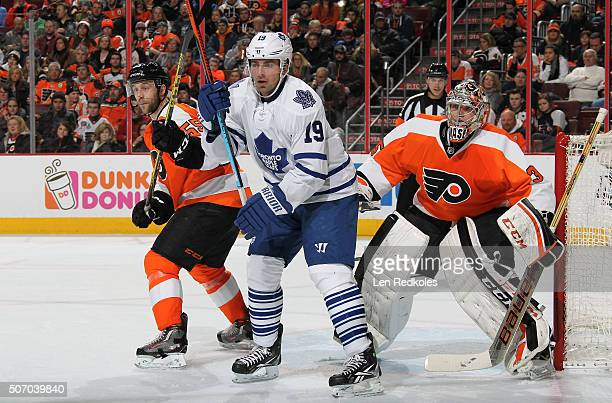 Nick Schultz and Steve Mason of the Philadelphia Flyers battle against Joffrey Lupul of the Toronto Maple Leafs on January 19 2016 at the Wells Fargo...