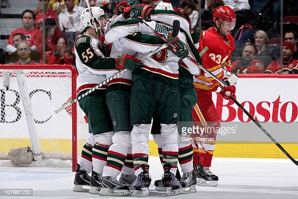 Nick Schultz, Marek Zidlicky and teammates of the Minnesota Wild celebrate a goal against the Calgary Flames on December 18, 2010 at the Scotiabank...