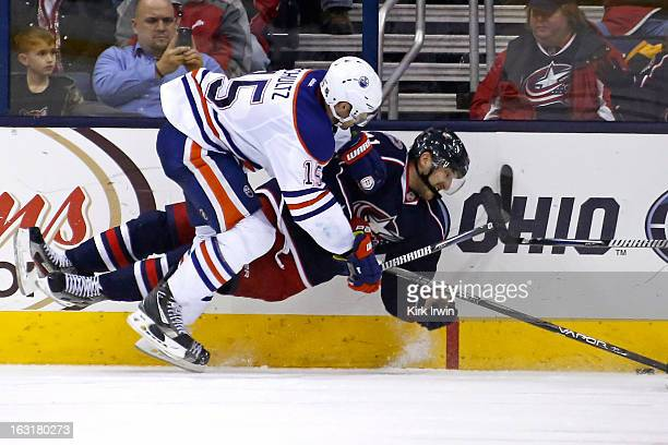 Nick Schultz of the Edmonton Oilers knocks down Nick Foligno of the Columbus Blue Jackets during the overtime period on March 5 2013 at Nationwide...