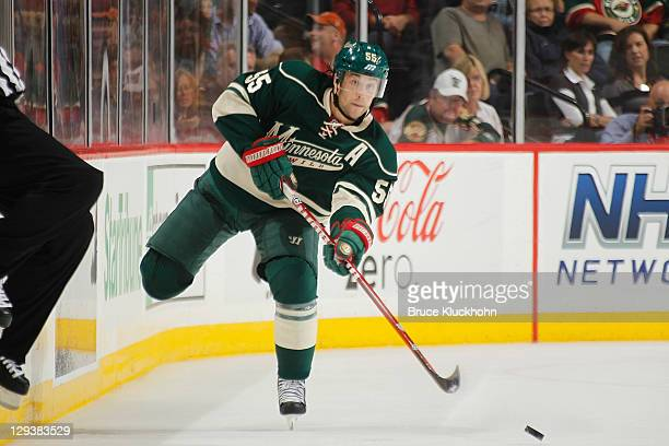 Nick Schultz of the Minnesota Wild delivers a pass against the Columbus Blue Jackets during the game at the Xcel Energy Center on October 8, 2011 in...