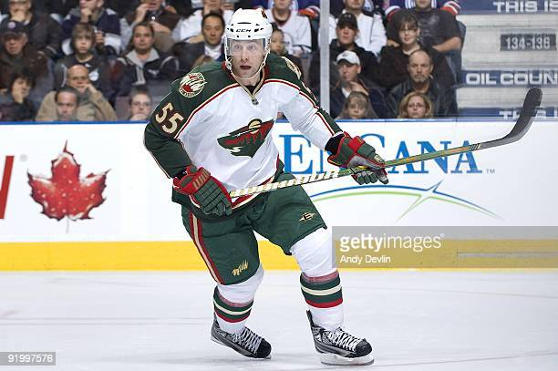 Nick Schultz of the Minnesota Wild follows the play against the Edmonton Oilers at Rexall Place on October 16, 2009 in Edmonton, Alberta, Canada. The...