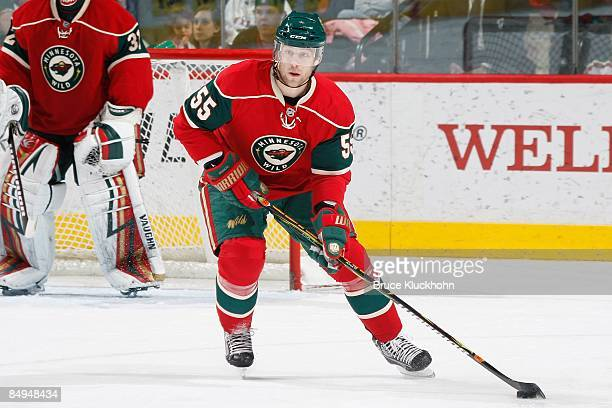 Nick Schultz of the Minnesota Wild handles the puck against the Ottawa Senators during the game at the Xcel Energy Center on February 14, 2009 in...