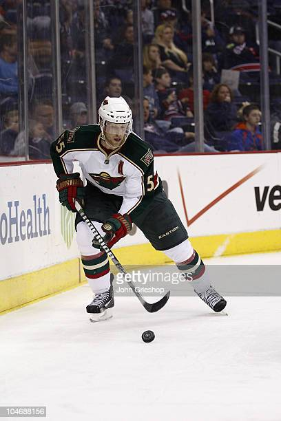 Nick Schultz of the Minnesota Wild pushes the puck up ice during the second period against the Columbus Blue Jackets on September 28, 2010 at...