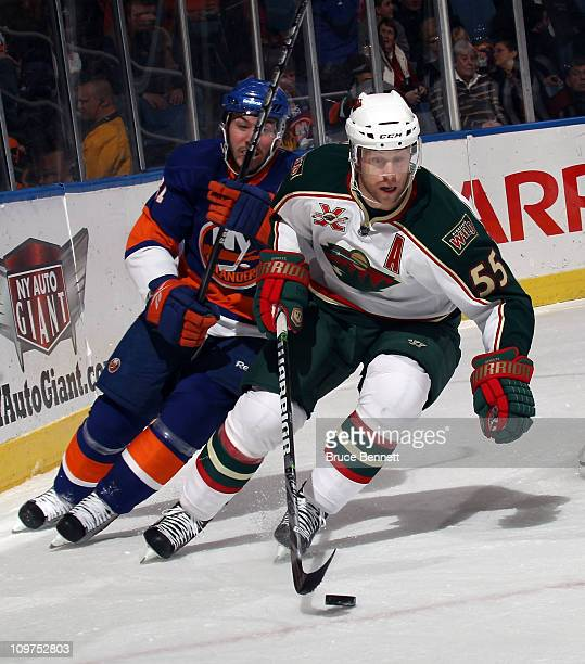 Nick Schultz of the Minnesota Wild skates against the New York Islanders at the Nassau Coliseum on March 2, 2011 in Uniondale, New York. The...