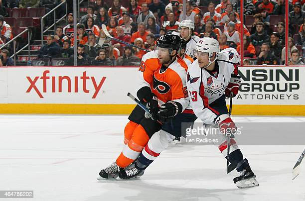 Nick Schultz of the Philadelphia Flyers battles against Jay Beagles of the Washington Capitals on February 22, 2015 at the Wells Fargo Center in...