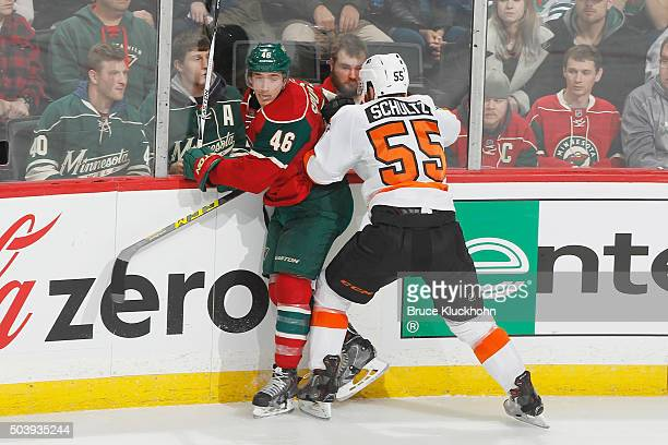 Nick Schultz of the Philadelphia Flyers checks Jared Spurgeon of the Minnesota Wild during the game on January 7, 2016 at the Xcel Energy Center in...