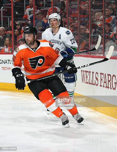 Nick Schultz of the Philadelphia Flyers plays skates against Daniel Sedin of the Vancouver Canucks on January 12, 2017 at the Wells Fargo Center in...