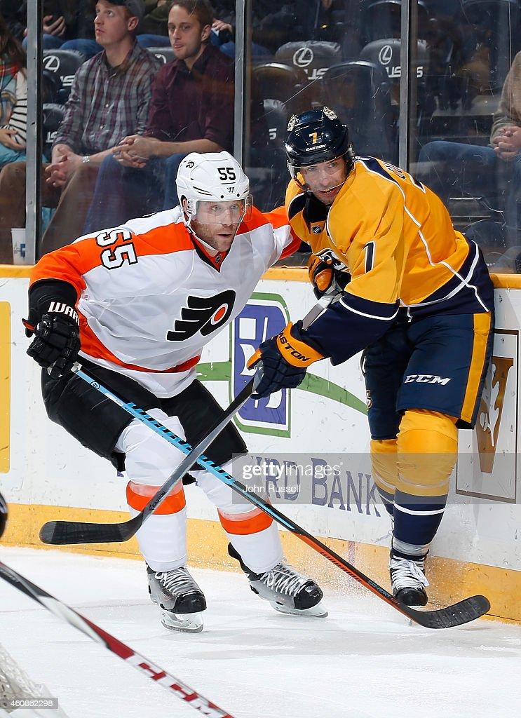 Nick Schultz #55 of the Philadelphia Flyers skates against Matt Cullen #7 of the Nashville Predators at Bridgestone Arena on December 27, 2014 in Nashville, Tennessee.
