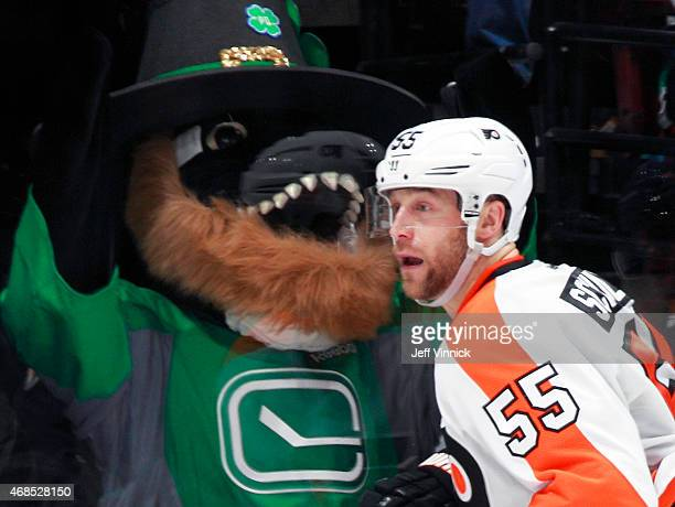 Nick Schultz of the Philadelphia Flyers skates by the Canucks mascot Fin during their NHL game against the Vancouver Canucks at Rogers Arena March...