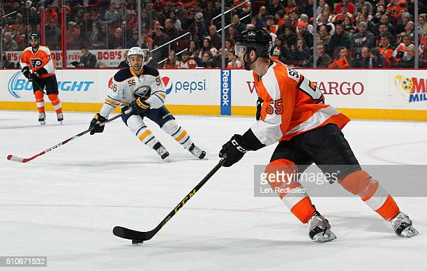 Nick Schultz of the Philadelphia Flyers skates the puck out of his zone against Justin Bailey of the Buffalo Sabres on February 11, 2016 at the Wells...