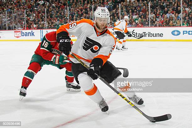 Nick Schultz of the Philadelphia Flyers skates with the puck while Jason Zucker of the Minnesota Wild defends during the game on January 7, 2016 at...