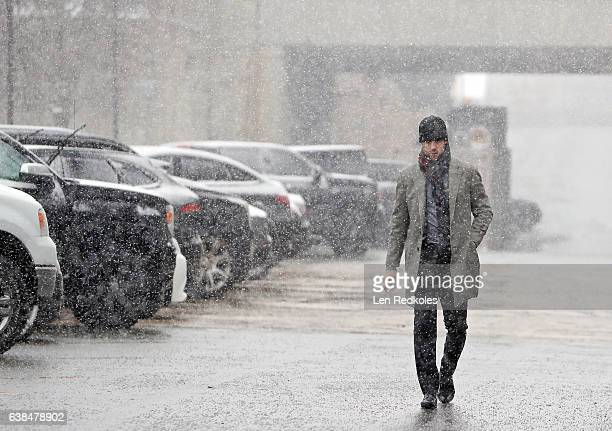 Nick Schultz of the Philadelphia Flyers walks through the parking lot during a snowstorm several hours before his game against the Tampa Bay...