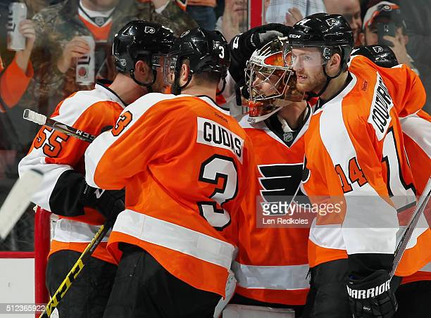 Nick Schultz Radko Gudas Michal Neuvirth and Sean Couturier of the Philadelphia Flyers celebrate after defeating the Minnesota Wild 32 on February 25...