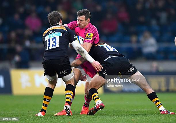 Nick Scott of London Welsh is wrapped up by Elliott Daly and Chris Bell of Wasps during the Aviva Premiership match between Wasps and London Welsh at...