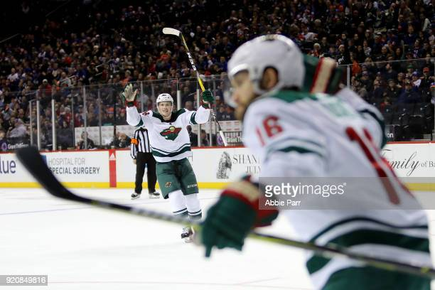 Nick Seeler of the Minnesota Wild celebrates after a goal by Jason Zucker of the Minnesota Wild in the third period during their game at Barclays...