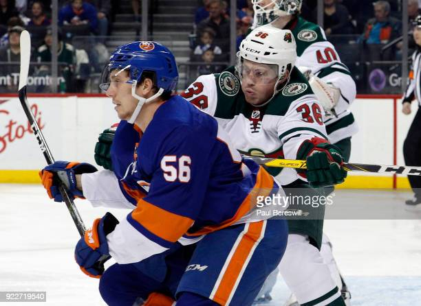 Nick Seeler of the Minnesota Wild checks Tanner Fritz of the New York Islanders in an NHL hockey game at Barclays Center on February 19 2018 in the...