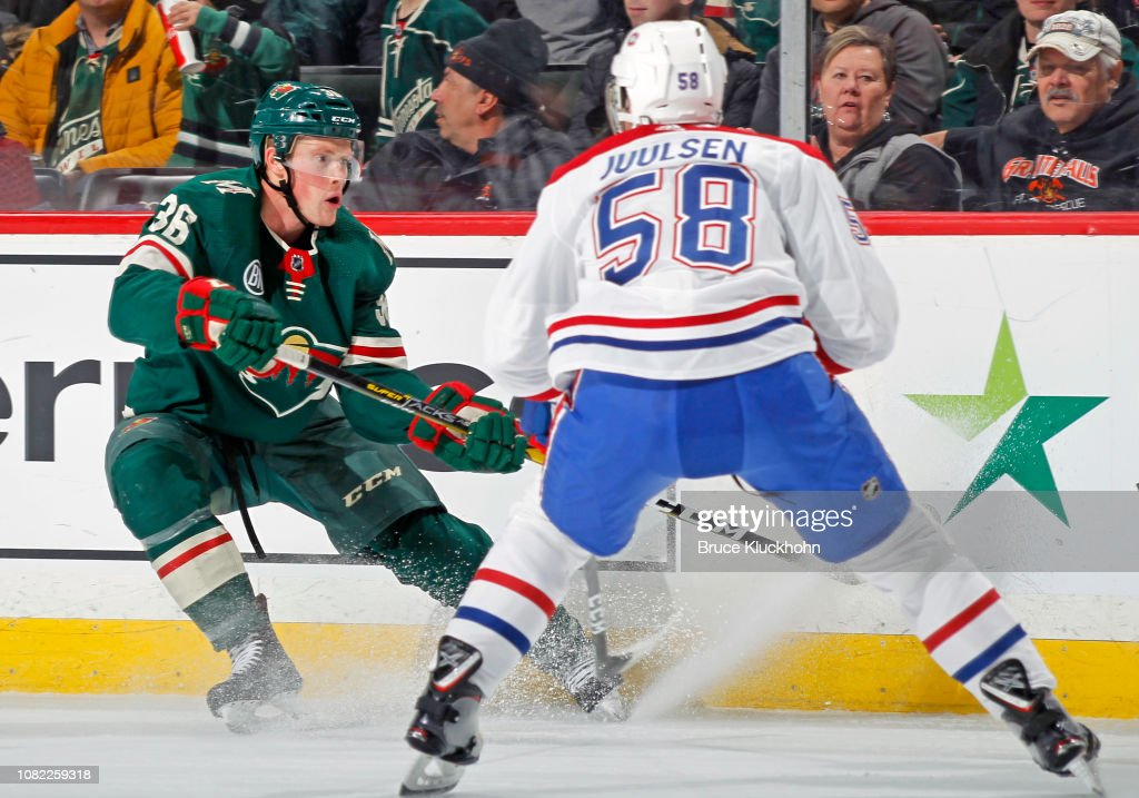 Nick Seeler of the Minnesota Wild chips the puck in as ...
