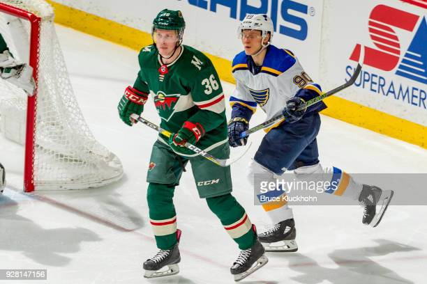 Nick Seeler of the Minnesota Wild defends Nikita Soshnikov of the St Louis Blues during the game at the Xcel Energy Center on February 27 2018 in St...