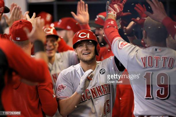 Nick Senzel of the Cincinnati Reds celebrates with teammates after hitting a home run in the seventh inning against the Milwaukee Brewers at Miller...