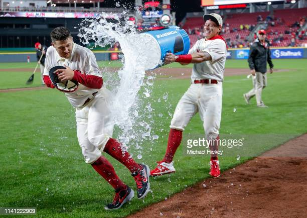 Nick Senzel of the Cincinnati Reds gets a celebratory soaking from Derek Dietrich of the Cincinnati Reds following the game against the San Francisco...