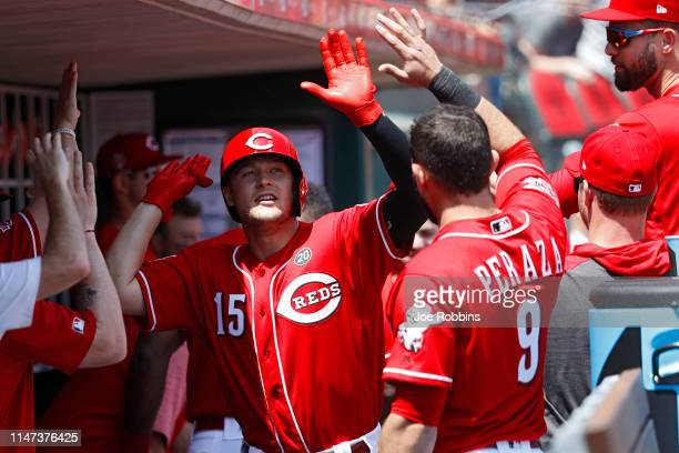 Nick Senzel of the Cincinnati Reds is congratulated in the dugout after hitting his second home run of the game in the second inning against the San...