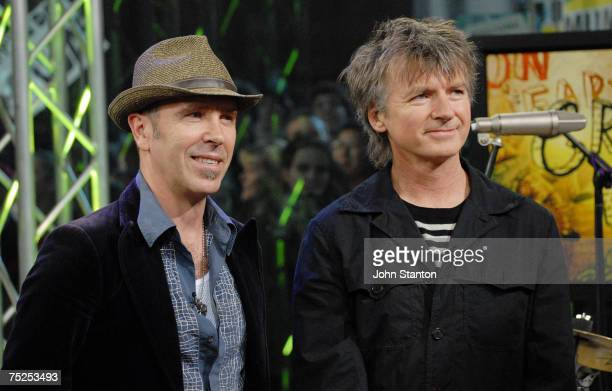 Nick Seymour and Neil Finn of Australian band Crowded House perform on the breakfast show Sunrise to kick off their reunion tour on July 6 2007 in...