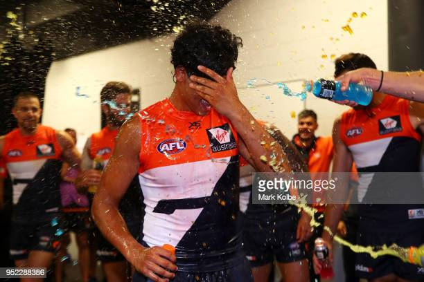 Nick Shipley of the Giants is showered in Gaterade as he celebrates victory with his team after the round six AFL match between the Greater Western...