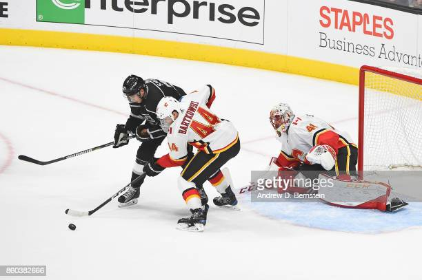 Nick Shore of the Los Angeles Kings battles for the puck against Matt Bartkowski of the Calgary Flames at STAPLES Center on October 11 2017 in Los...
