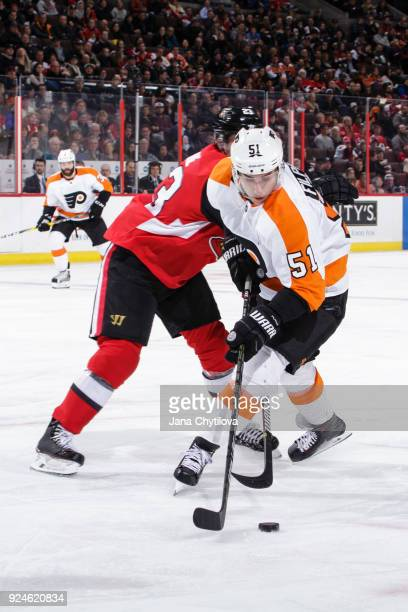Nick Shore of the Ottawa Senators battles for the loose puck against Valtteri Filppula of the Philadelphia Flyers at Canadian Tire Centre on February...