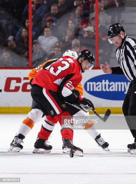 Nick Shore of the Ottawa Senators pulls the puck back off the faceoff against Valtteri Filppula of the Philadelphia Flyers in the second period at...