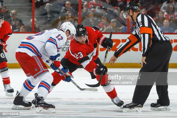 Nick Shore of the Ottawa Senators takes a faceoff against Peter Holland of the New York Rangers at Canadian Tire Centre on February 17 2018 in Ottawa...