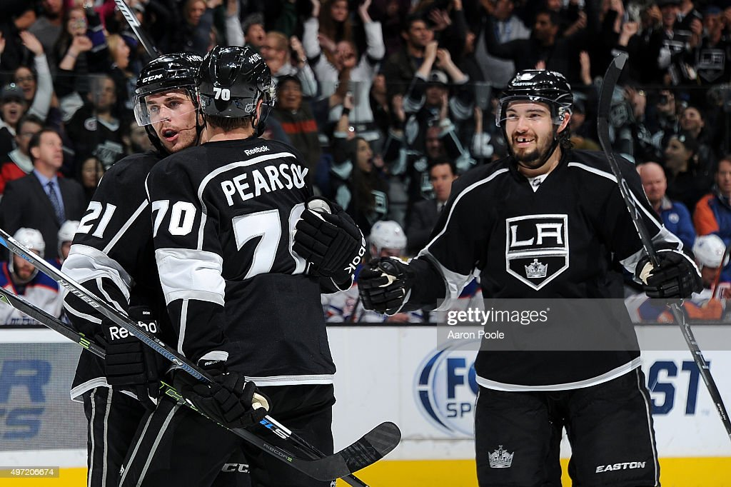 Nick Shore #21, Tanner Pearson #70, and Drew Doughty #8 of the Los Angeles Kings celebrate during a game against the Edmonton Oilers at STAPLES Center on November 14, 2015 in Los Angeles, California.