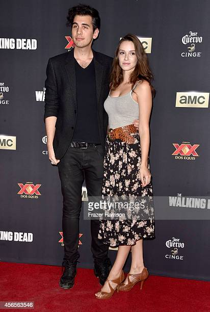 """Nick Simmons and guest attend the season 5 premiere of """"The Walking Dead"""" at AMC Universal City Walk on October 2, 2014 in Universal City, California."""
