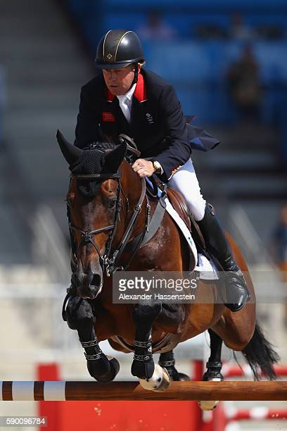 Nick Skelton of Great Britain rides Big Star during the Team Jumping on Day 11 of the Rio 2016 Olympic Games at the Olympic Equestrian Centre on...